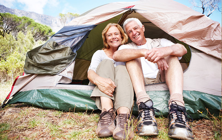 Senior couple in love, hiking and camping